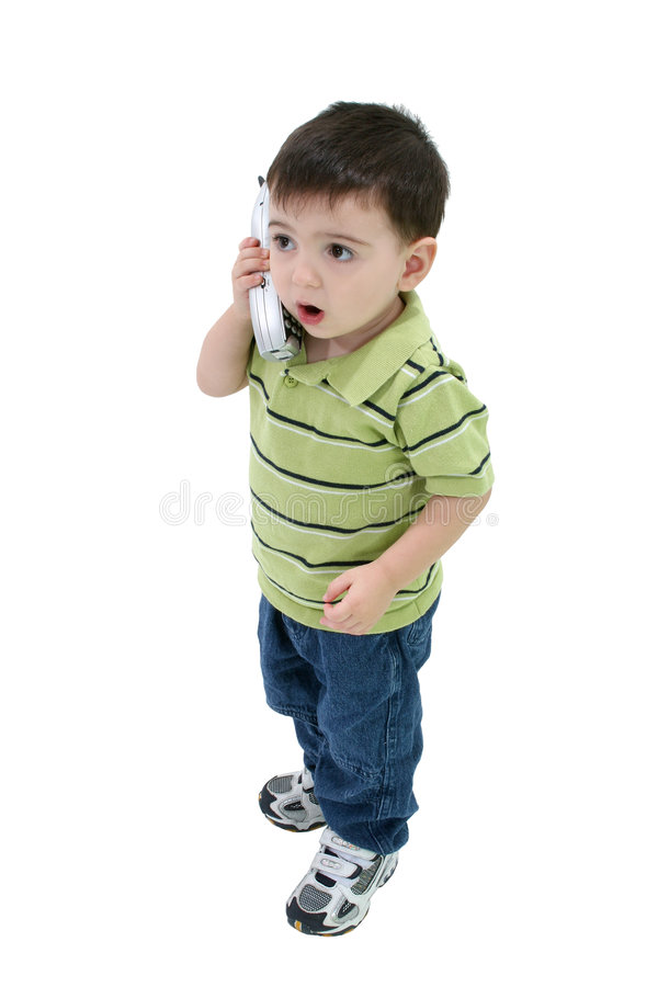 Garçon adorable parlant au téléphone de Chambre au-dessus du blanc photographie stock libre de droits