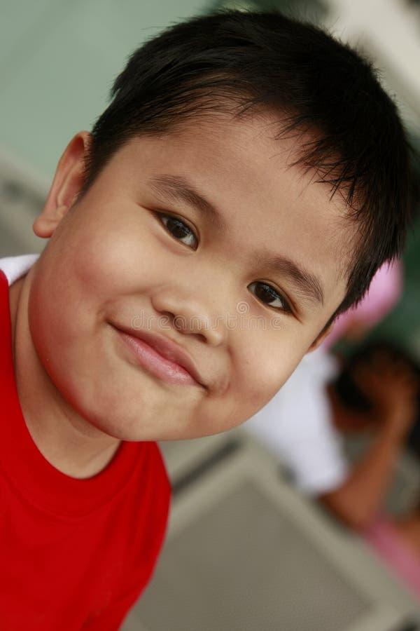 Garçon asiatique heureux photos stock