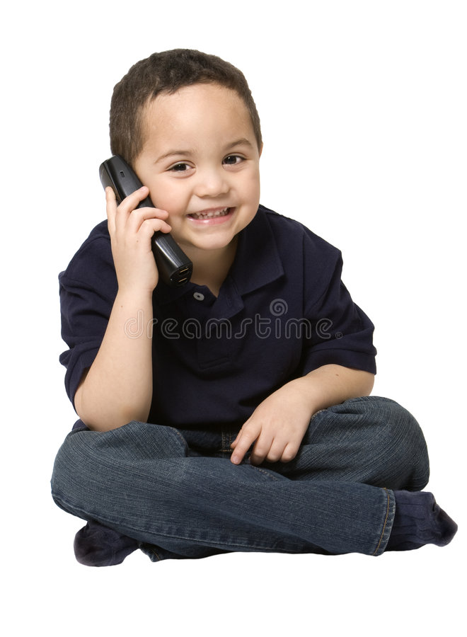 Garçon au téléphone photo stock