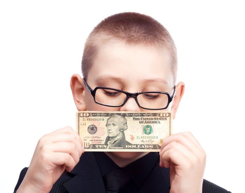 Garçon avec de l'argent images stock