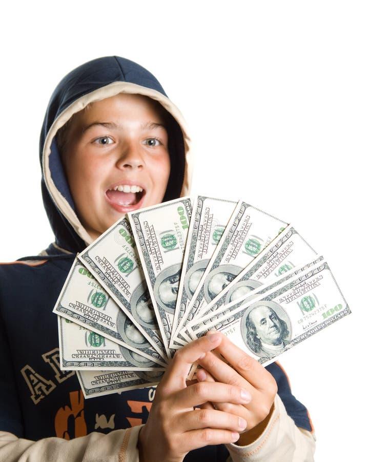 Garçon avec de l'argent photographie stock
