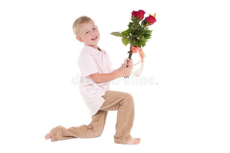 Garçon avec des fleurs photos libres de droits