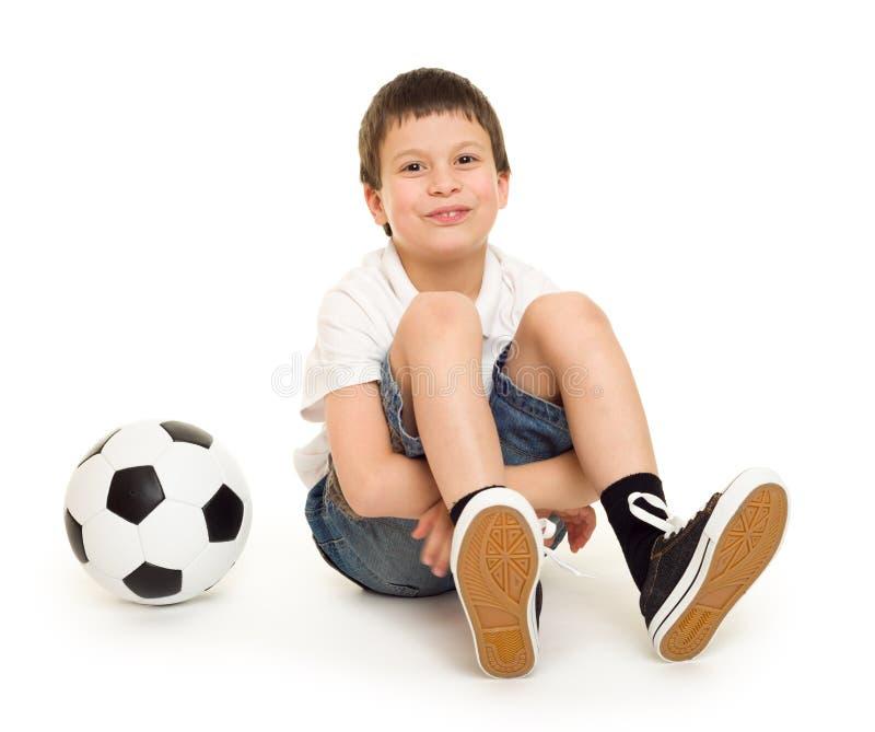 Garçon avec du ballon de football photographie stock