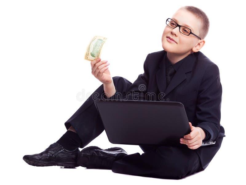 Garçon avec l'ordinateur portatif et l'argent images stock