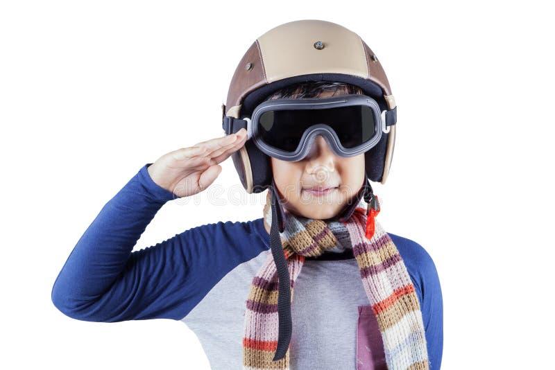 Garçon avec le casque et un geste de salutation images stock