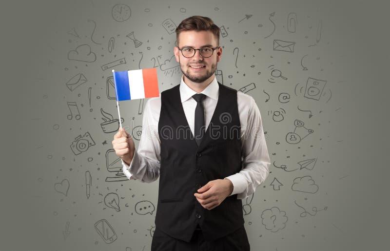 Garçon avec le concept et le drapeau de symbole de bureau photos stock