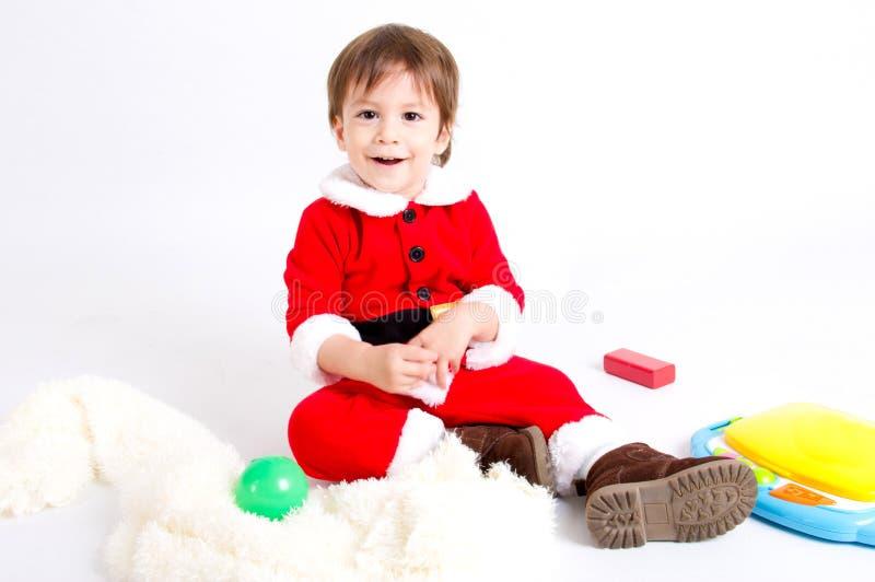 Garçon avec le costume de Santa photographie stock libre de droits