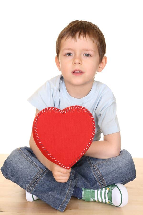 Garçon avec le grand coeur image libre de droits