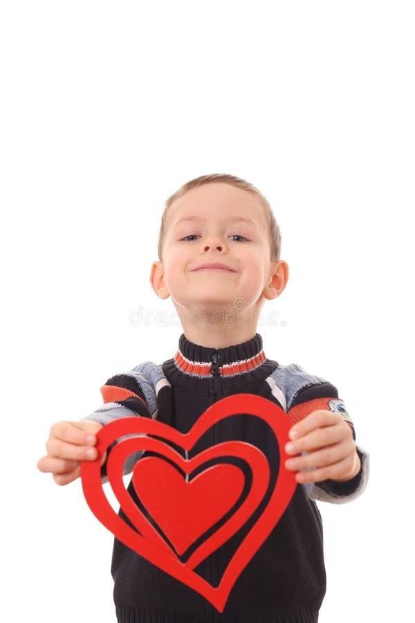 Garçon avec le grand coeur photo libre de droits