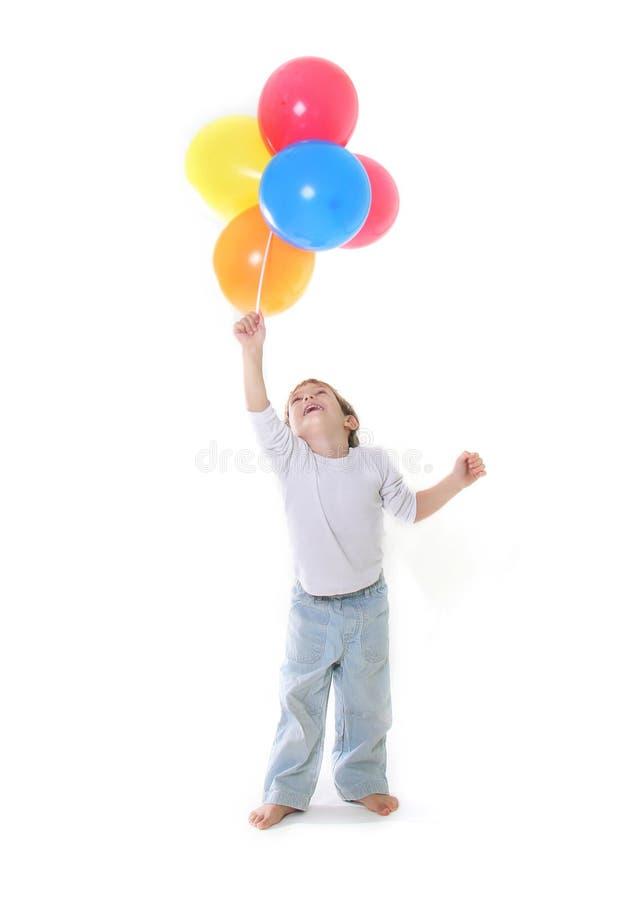 Garçon avec les ballons colorés au-dessus du blanc photos libres de droits