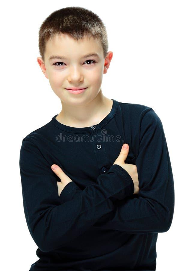 Garçon avec les bras croisés photos stock