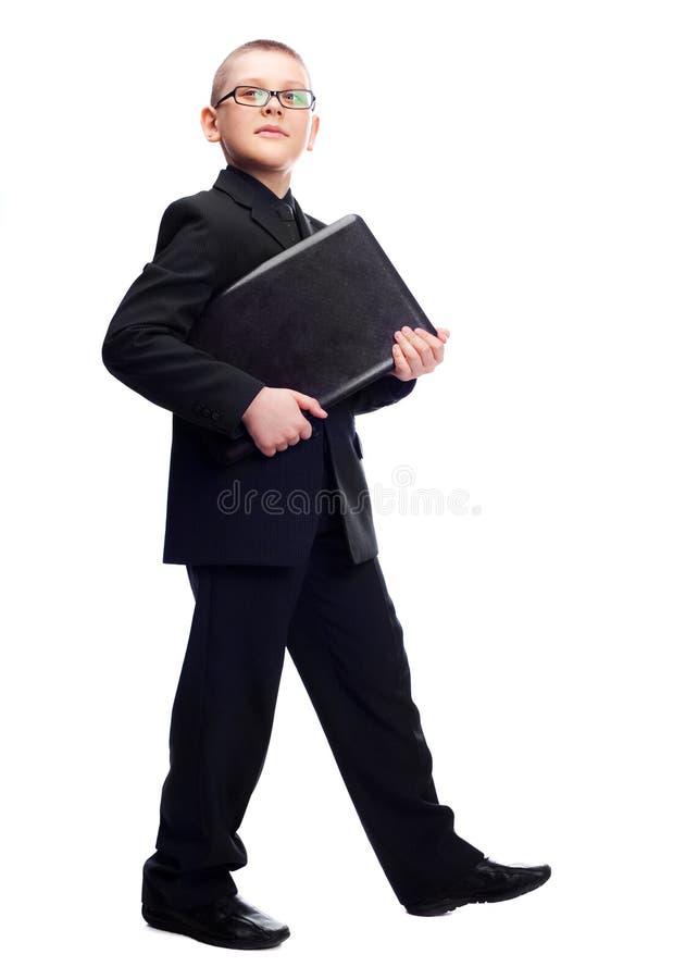 Garçon avec un ordinateur portatif images libres de droits