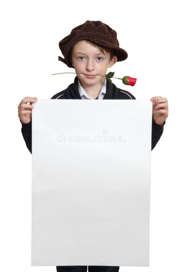 Garçon avec une feuille blanche image libre de droits