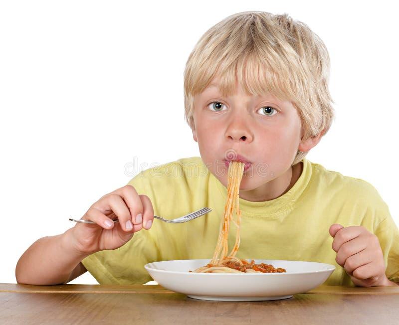 Garçon blond affamé image stock