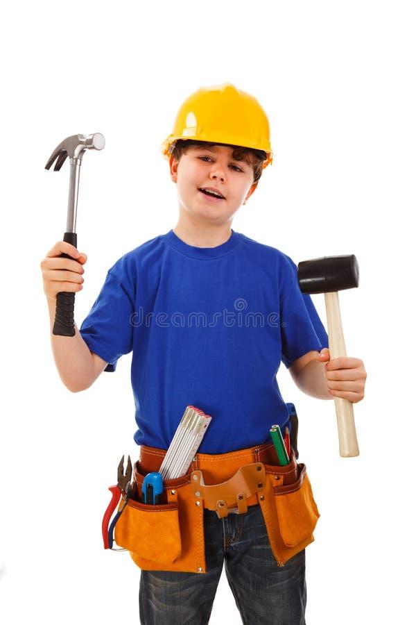 Garçon comme travailleur de la construction sur le fond blanc images libres de droits
