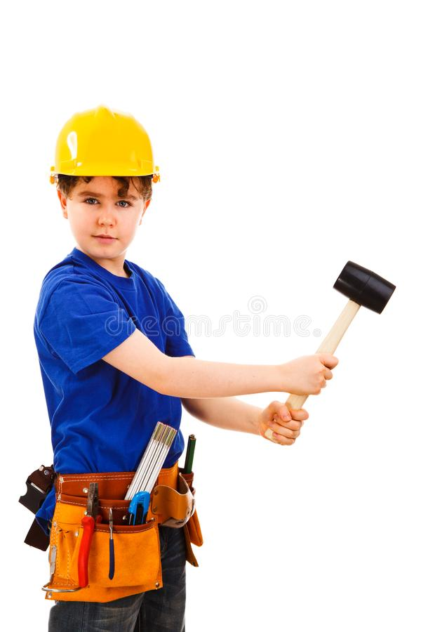 Garçon comme travailleur de la construction sur le fond blanc photographie stock libre de droits