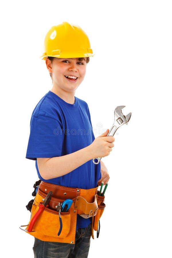 Garçon comme travailleur de la construction sur le fond blanc photo stock
