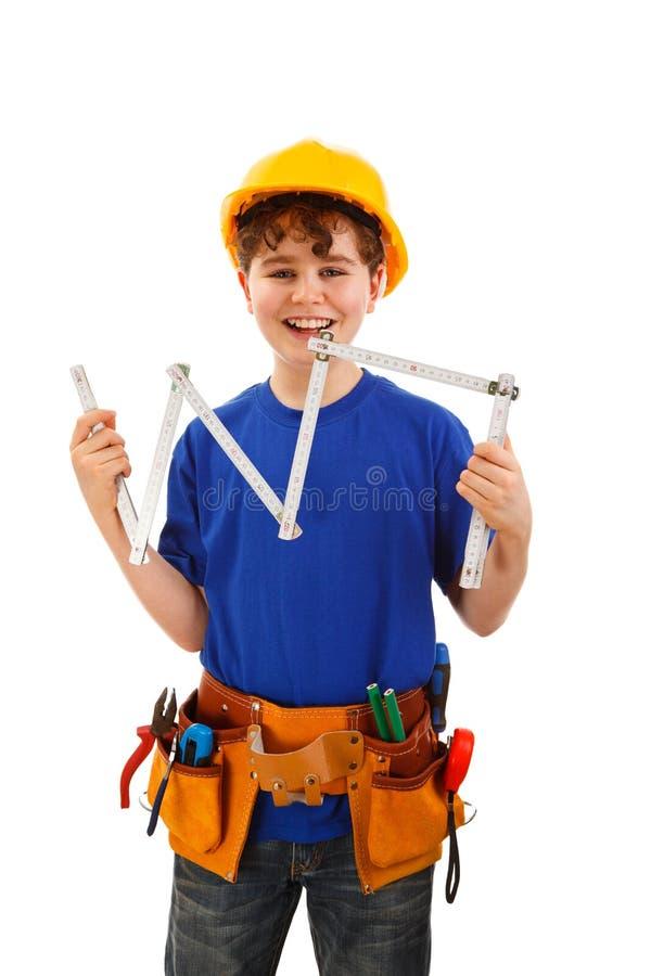 Garçon comme travailleur de la construction sur le fond blanc image libre de droits
