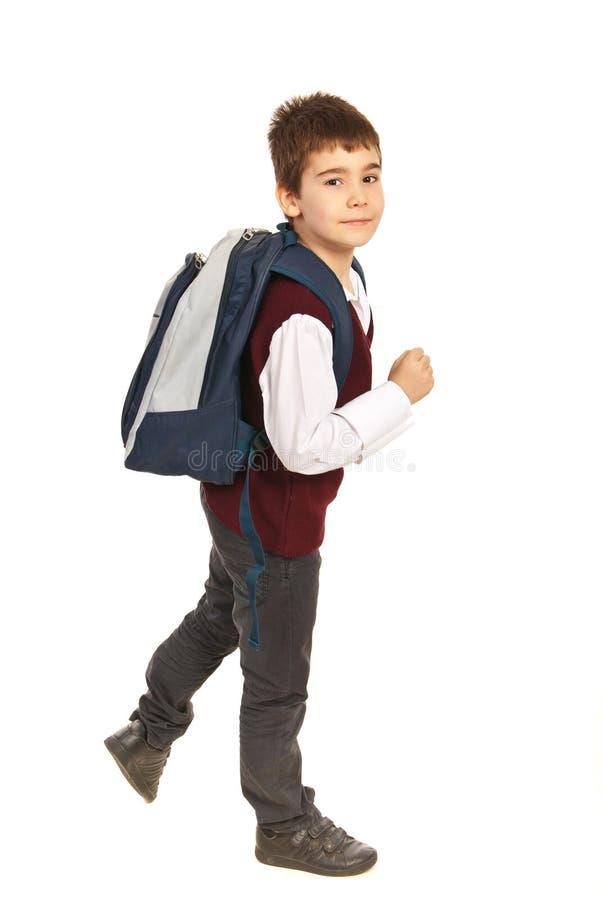 Garçon d'école de marche dans une hâte photos libres de droits