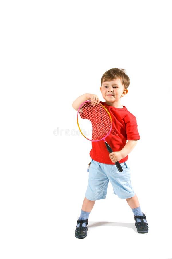 garçon de badminton peu jouant photographie stock