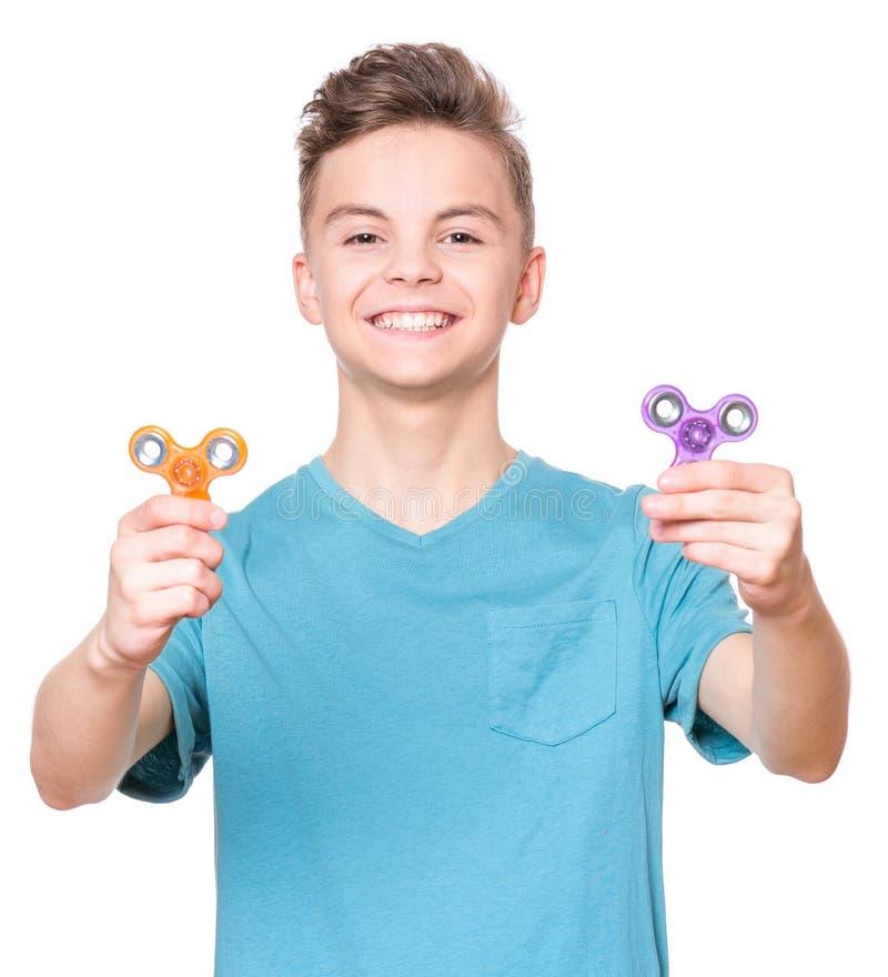 Garçon de l'adolescence avec le fileur photo libre de droits