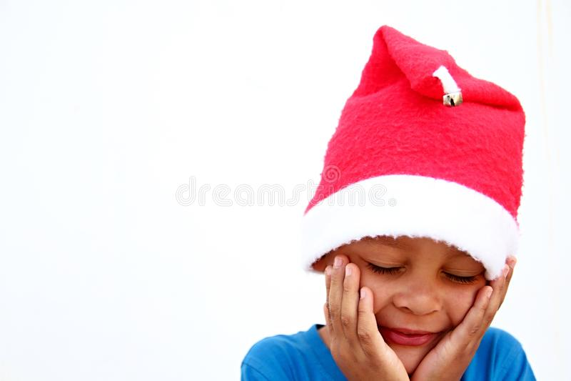 Garçon de Noël se sentant triste photos stock