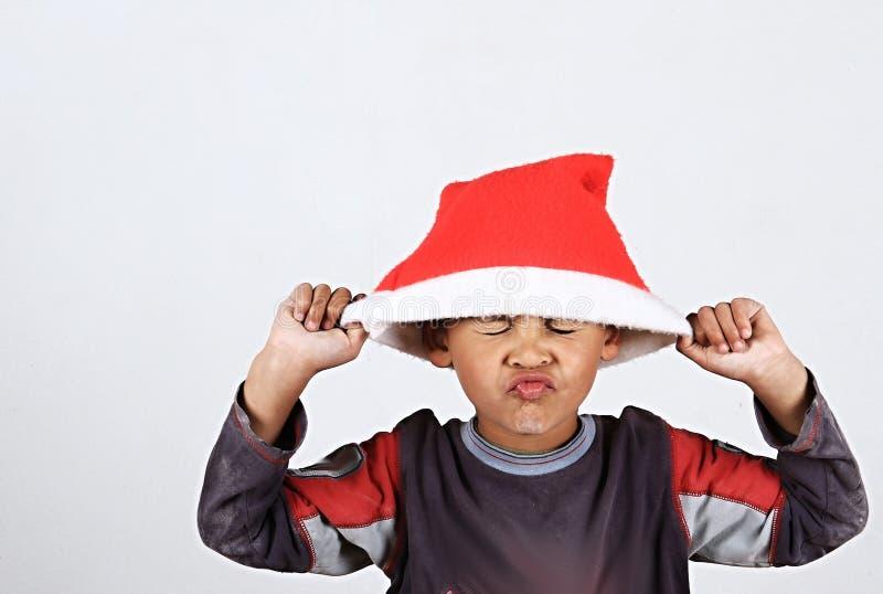 Garçon de Noël se sentant triste photos libres de droits
