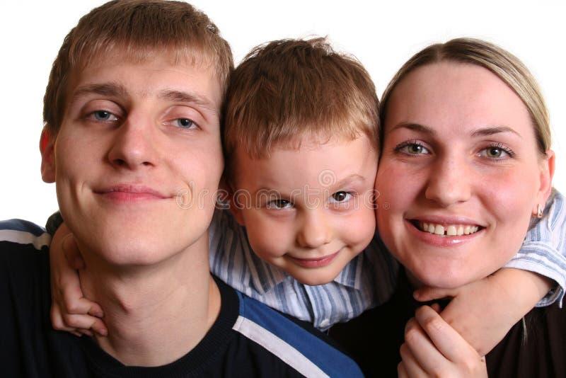 Garçon derrière des parents photographie stock libre de droits