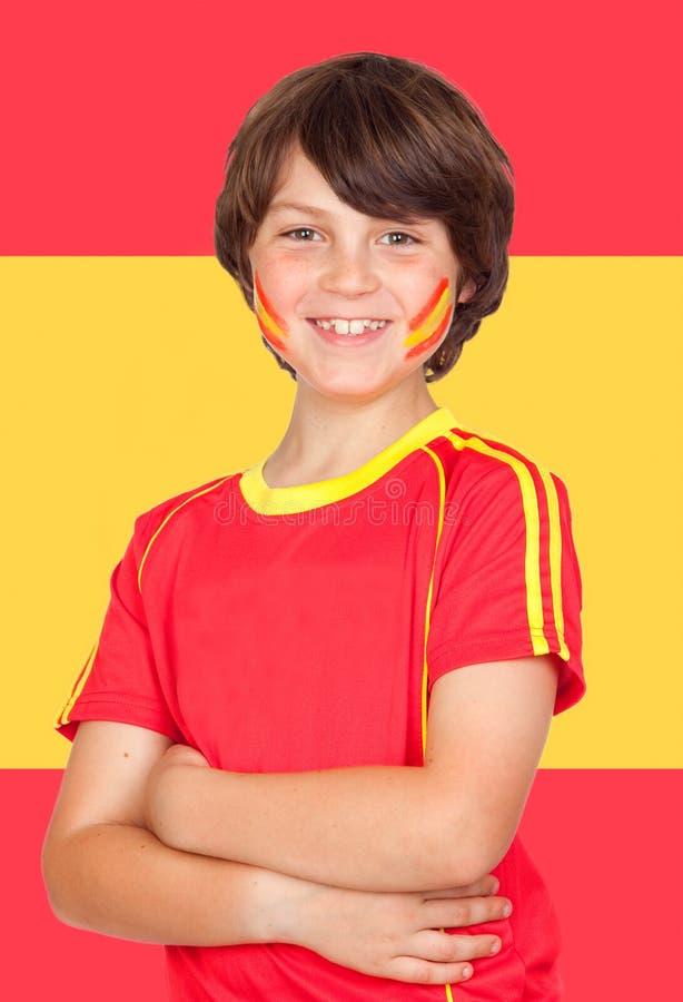 Garçon espagnol avec l'équipe de T-shirt et le drapeau de l'Espagne images libres de droits