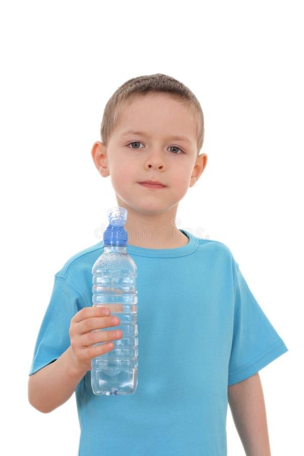 Garçon et bouteille de l'eau image libre de droits