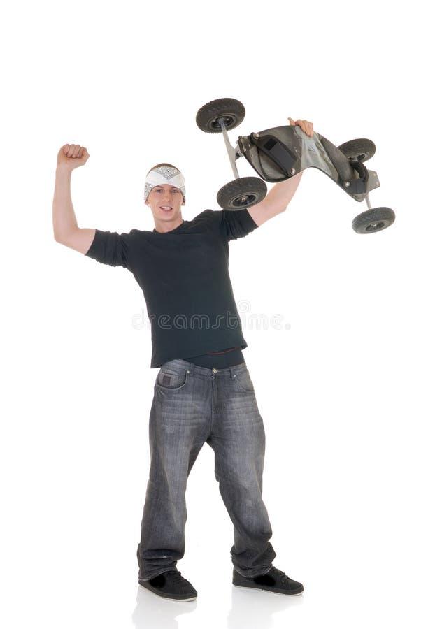 Garçon et sa planche à roulettes image libre de droits