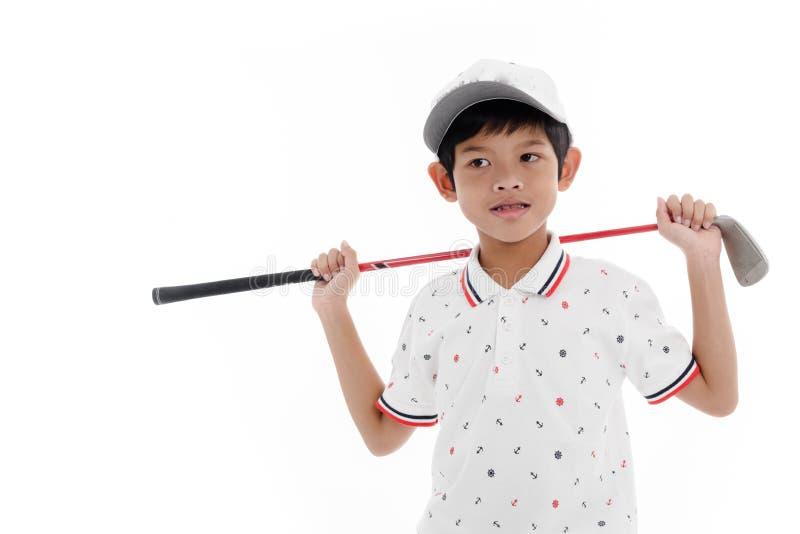 Garçon heureux tenant le club de golf photo libre de droits