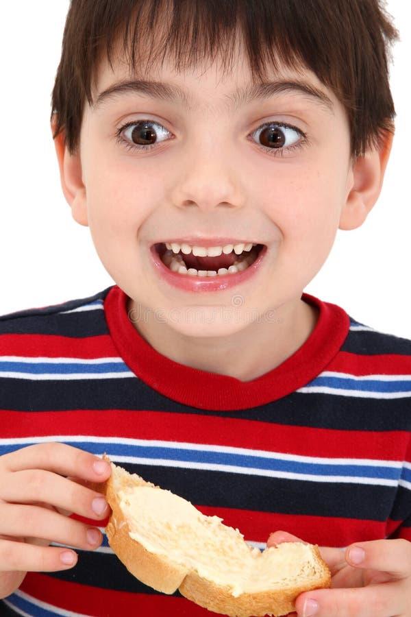 Download Garçon Mangeant Du Pain Grillé Image stock - Image du innocence, beurre: 8669405