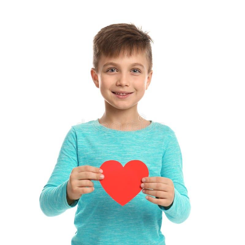 Garçon mignon avec le coeur décoratif photographie stock libre de droits
