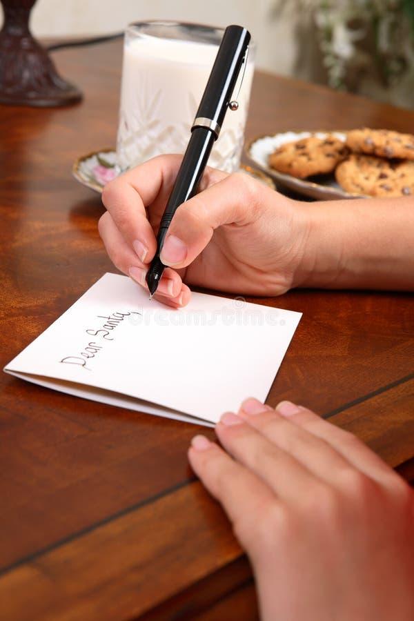 Garçon ou fille écrivant une lettre à Santa images libres de droits