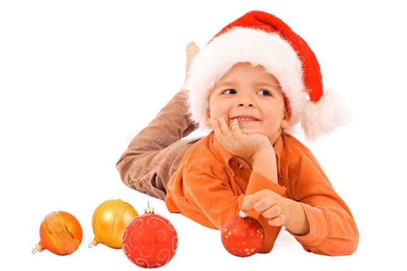 Garçon rêvant de Noël - d'isolement photo stock