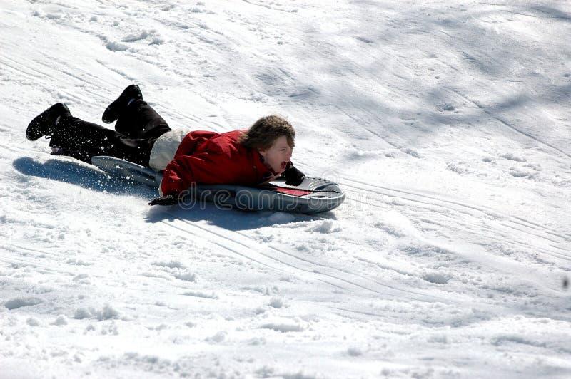 Garçon sledding photos stock