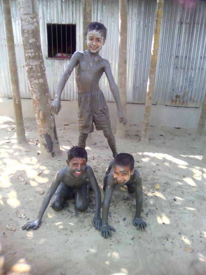 3 garçons images stock