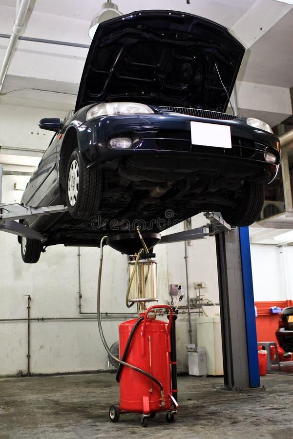 Garage. Repairing a car in the garage royalty free stock photos
