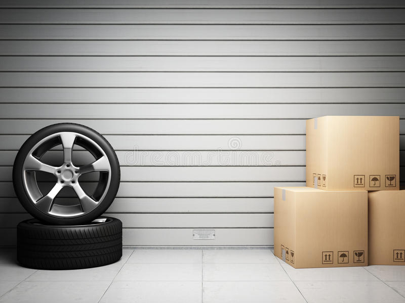 Garage with car spare parts. On background of roll up door