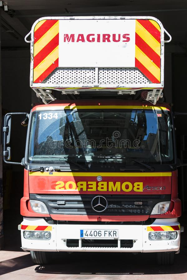 Garage of cars and equipment of the city fire department. MADRID, SPAIN - 26 MARCH, 2018: Garage of cars and equipment of the city fire department stock images