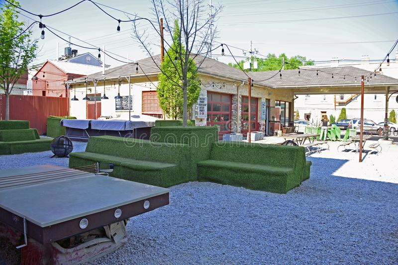 Garage converted to a restaurant with outdoor play and sitting area. On the side royalty free stock photos