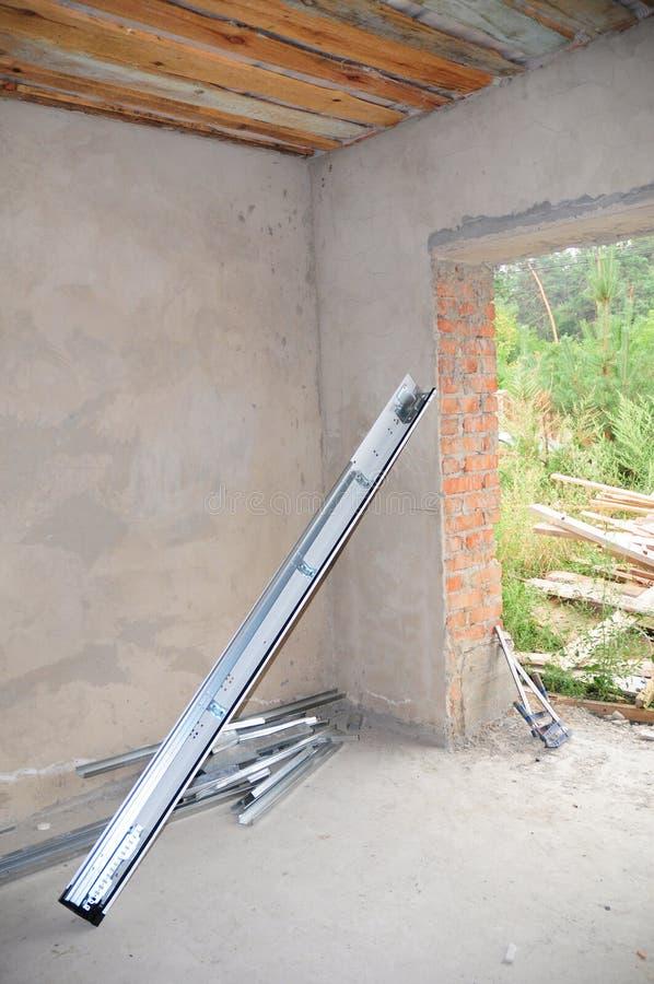 Garage Door Installation . Garage Door Post Rail and Spring Installation / Assembly. Garage Door Post Rail and Spring Installation / Assembly stock images