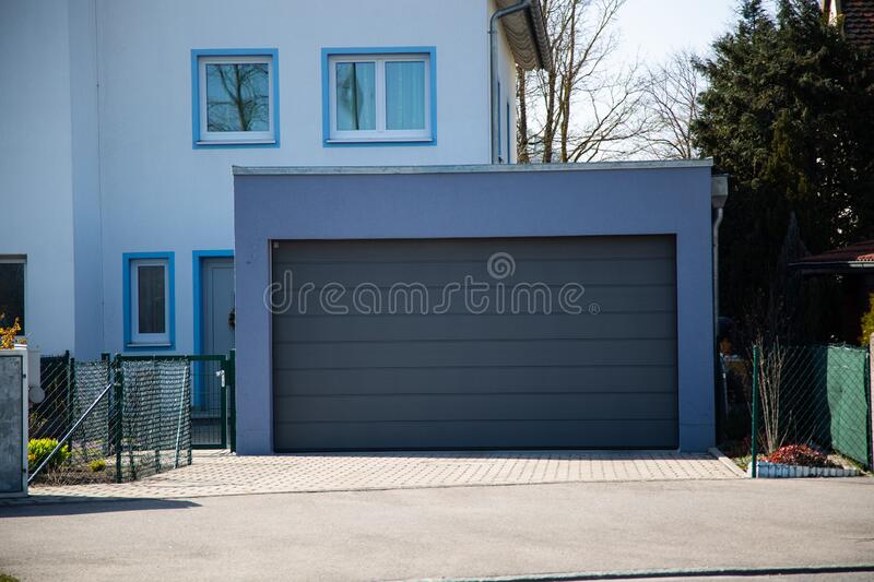 Garage door, modern garage door in gray. Luxury royalty free stock photos