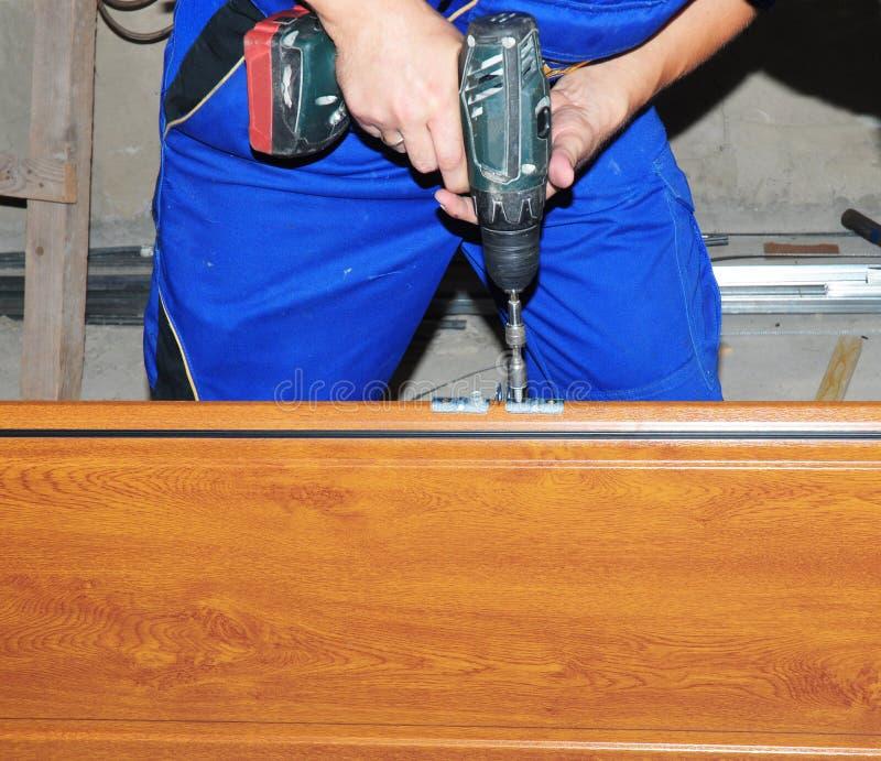 Garage Door Repair Constractor Installing Holder With Screwdriver