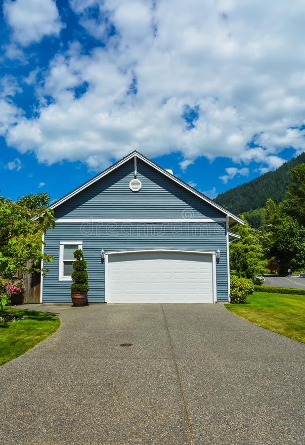 Garage door of residential house on a country side in British Columbia, Canada royalty free stock photography