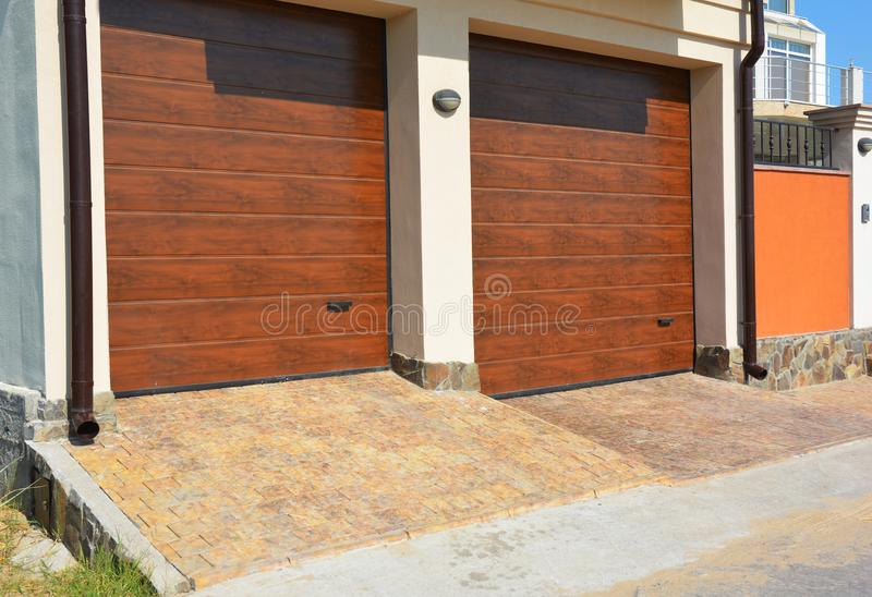 Download Garage Door For Two Cars With Pathway Pavement And Plastic Gutter  Pipes. Stock Image