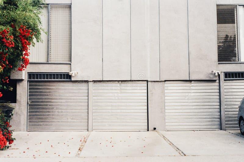 Garage doors on building exterior royalty free stock photos