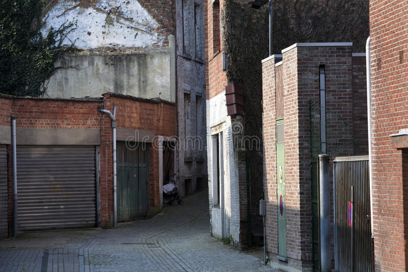 Download Garage Doors And A Small Alley Stock Image   Image Of Sign,  Housing: