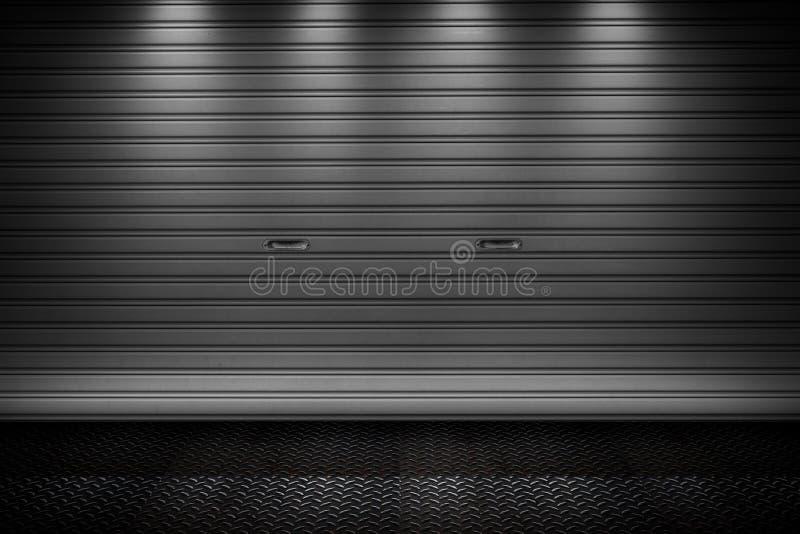 Garage or factory storage gate roller shutter doors metal floor building. With lighting background royalty free stock photos